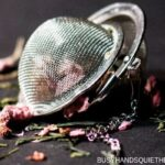 Stainless steel tea egg with loose leave herbal tea including rose petals