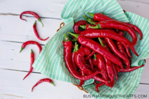 cayenne peppers in a basket lined with cloth