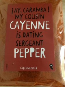 """cayenne pepper in bag with """"Ay Caramba, my cousin Cayenne is dating sergeant Pepper"""" on it."""