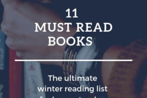 Hand reaching for a book on a bookshelf. Text overlay: 11 must read books. The ultimate winter reading list for homesteaders