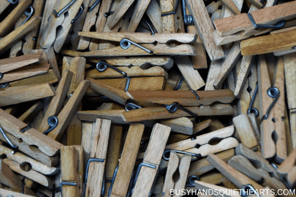 A bunch of wooden clothes pins.