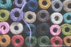Rolls of different coloured yarn photographed from above.