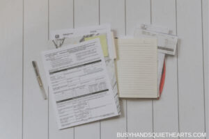 legal forms on top of a notebook