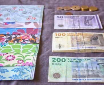 Cash envelopes and Danish currency lines up ready for envelope stuffing
