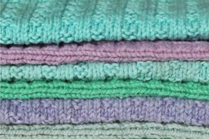 A colourful stack of knitted 'not another dishcloths'