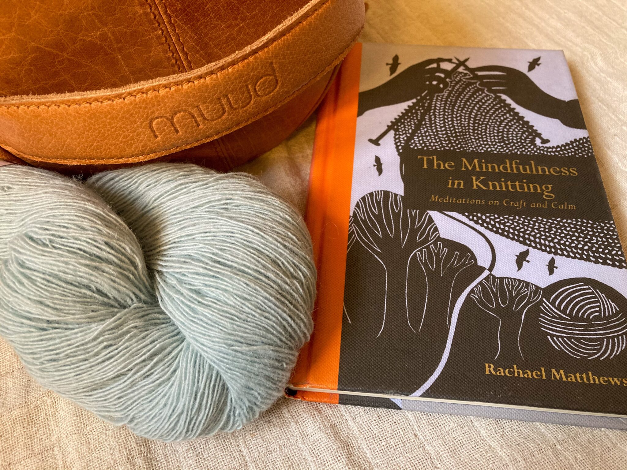 The Mindfulness in Knitting book and Muud Saturn bag along with yarn.